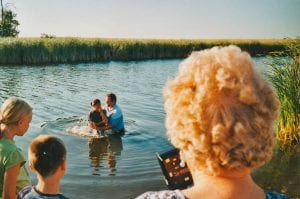 baptism in a lake in the country